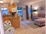 Living area & kitchen overlooking pool