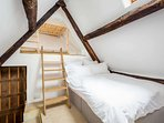 The quirky eaves bedroom - a double bed and ...