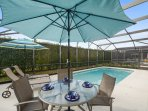 Enjoy time with family and friends on the screened in pool deck.
