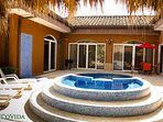 Private courtyard with pool, lounge chairs, BBQ, Patio table and hammock