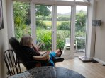 Relax in the Garden room and watch the goldfinches and horses in the field