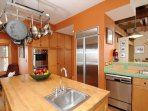This fully equipped kitchen has top of the line appliances and amenities.