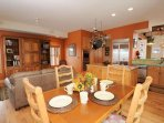 Adjoining the kitchen is a more casual seating area that will seat up to six at a time.