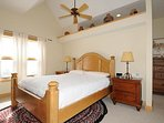 The master bedroom with a king bed.