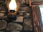 hand made vintage lighting on restored rock wall in kitchen of main floor historic suite