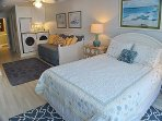 Master suite with extra seating and fridge
