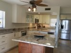 Beautiful kitchen with island bar entertaining area.