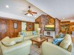 4/34: Living room with 55 in. Smart TV, longer shot