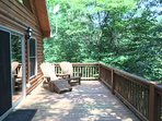 Large open deck overlooking the rushing creek