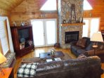 Greatroom with stone fireplace & HDTV