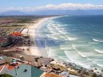 Muizenberg beach just down the road. Great to learn to surf