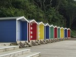 Beach huts walking on the coastal path from Colwell Bay towards Totland Bay.