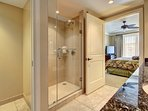 Both bathrooms feature a double granite vanity, walk-in shower, and soaking tub