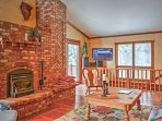 Curl up in front of the wood-burning stove as you relax on the sofa.