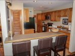 Fully Furnished Kitchen with Bar Seating for 3
