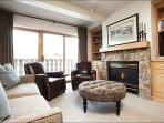 Elegant Living Room has a Gas Fireplace and Balcony Access
