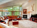 Spacious Living Room has a Gas Fireplace and Large Flat Screen TV