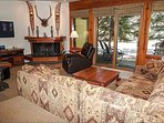 Flat-Screen TV and a Wood-Burning Fireplace in the Living Room Overlooking Gore Creek