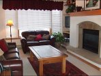Leather Furnishings and a Gas Fireplace in the Living Room