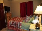Bedroom with Queen Bed and Large Flat Screen TV