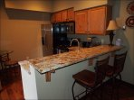 Lock Off Kitchen with Granite Counter Tops and Breakfast Bar Seating for Two