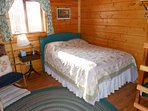 Bunkhouse - new double mattress with antique headboard