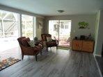 Sunroom area with open floor plan.