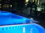 Alvera Beach Apartments at Night. Shows the swimming pool and the apartments.
