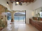 The master shower turns showering into a show of natural beauty, with pelicans flying close by.