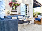 Ample seating on the terrace overlloking the pool and the garden beyond