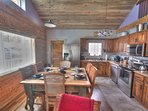 Exposed log walls throughout.  Large farm table great for game night!