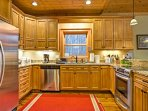Whip up a delicious creation in the fully equipped kitchen, complete with stainless steel appliances.