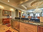 6-burner gas cooktop, granite counters, large breakfast bar, and a wine refrigerator are just a few of the many...