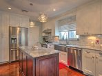 Everyone in your group is sure to love the fully equipped gourmet kitchen, featuring granite countertops and stainless...