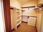 Upper level master bedroom with a King bed, flat screen cable TV, large walk-in closet, arm chair and a private bathroom