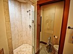 Upper level master bathroom with his & her sinks and a dual headed tiled shower