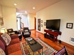Lower level family room with a large flat screen TV/Blu-Ray player, hide-a-bed couch for additional sleeping, two...