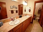 Lower level large hall bathroom with dual sinks