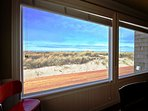 Dining area distant ocean view and beautiful dune grass