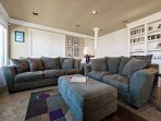 Living room with a flat screen cable TV/Blu-Ray DVD player, wood burning fireplace, couch, love seat with ottoman and...