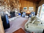 Living room with satellite TV/DVD player, surround sound, CD player, wood burning fireplace, hide-a-bed couch, two...