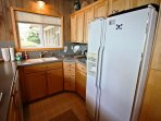 Fully equipped kitchen with all appliance-Jenn-Air gas cook top stove, wall oven and dining table for six