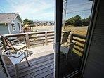 Master bedroom balcony with distant ocean views.