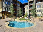 Relax after a long day in the large hot tub on amenity deck