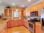 With stainless steel appliances & granite countertops