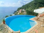Private swimming pool and terrace with sea views
