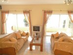 Open plan living area with WiFi, TV, DVD player and terrace access