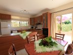 Equipped kitchen and dining area with terrace access