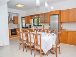 Equipped open plan kitchen and dining area