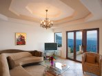 Living room with WiFi, TV, DVD Player and sea views